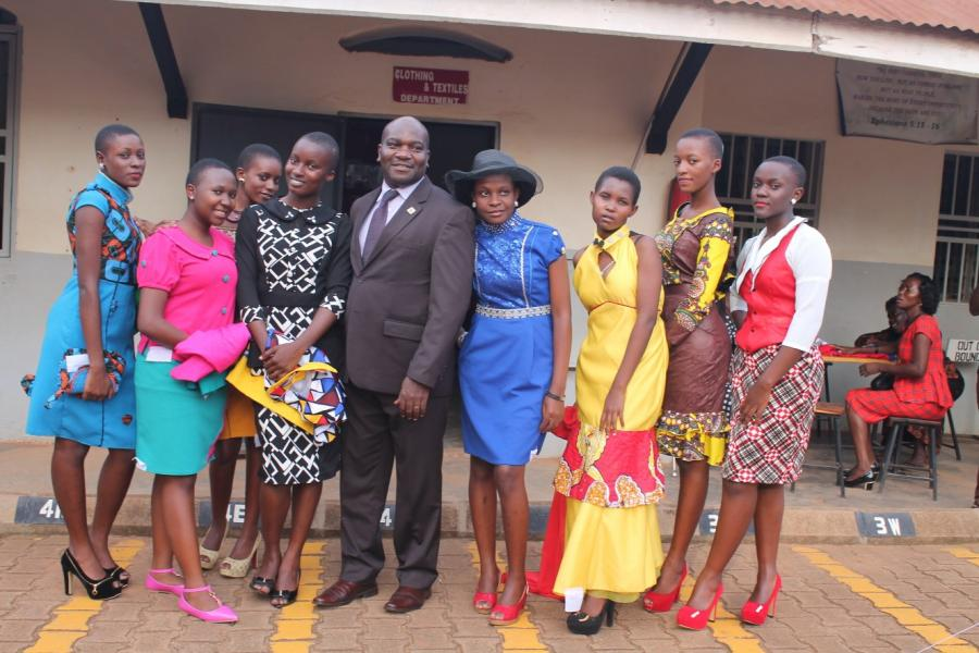 UACE Clothing and Textile Students with Headteacher